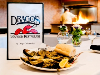 Charbroiled oysters next to a Drago's menu in the Empire Room